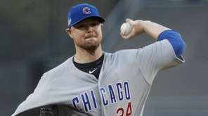 Jon Lester of the Chicago Cubs pitches in