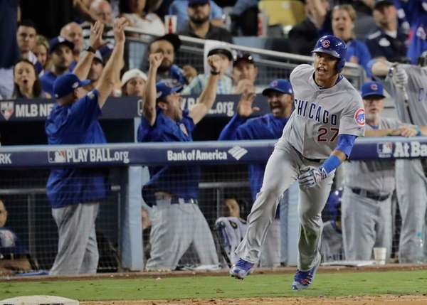 Chicago Cubs' Addison Russell celebrates his two-run home