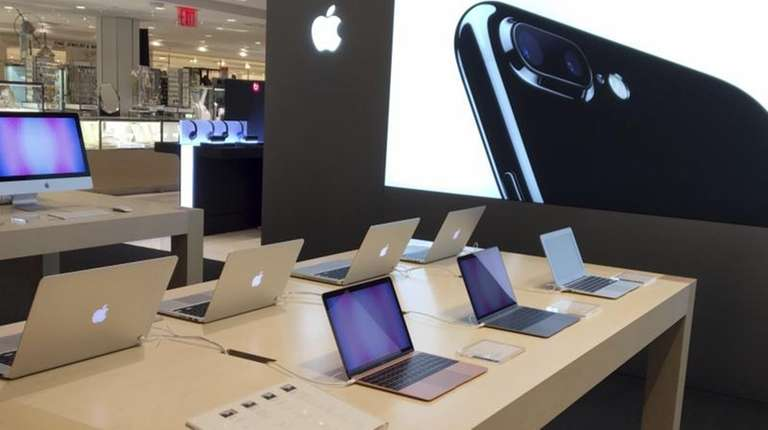 Apple products appear on display at Macy's flagship