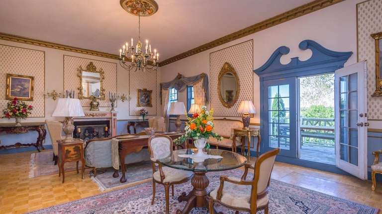 Water Mill home with Federal Colonial style lists for 25M Newsday