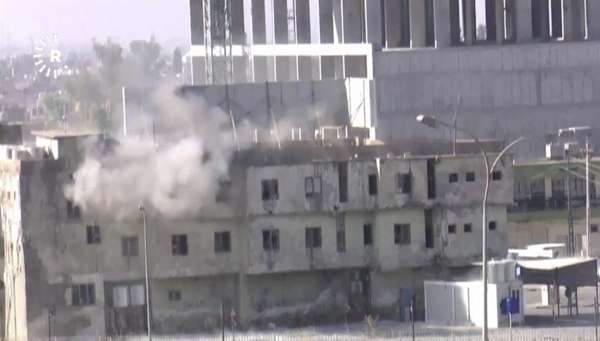 In this image made from video, smoke rises