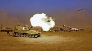 Iraqi forces fight to retake several key