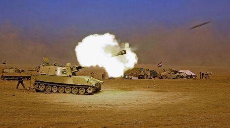 Iraqi forces fight to retake several key