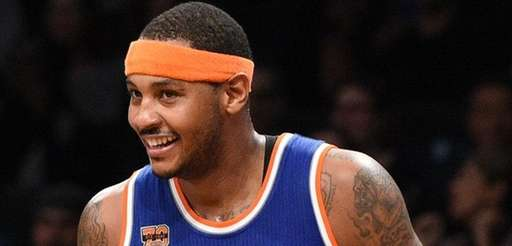 Knicks forward Carmelo Anthony reacts after he sinks
