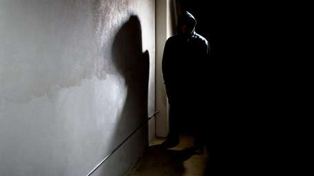 A man standing in a shadow.