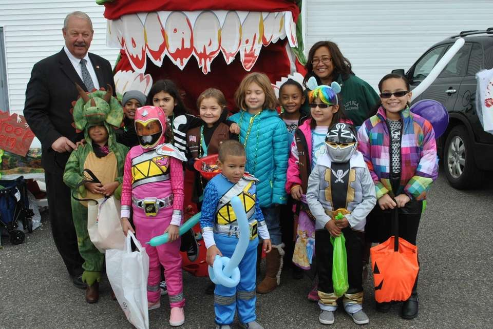Mayor Kennedy and Trustee Pineyro and Trunk-or-Treat participants.
