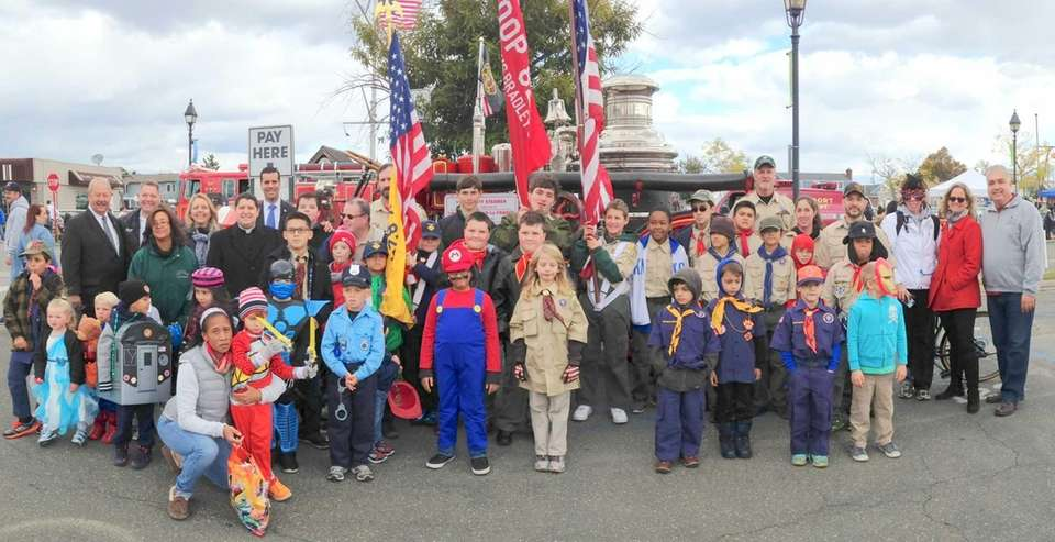 Mayor Kennedy and parade participants celebrate the beginning
