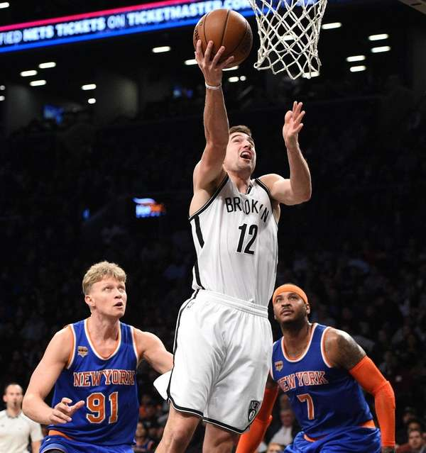 Brooklyn Nets' guard Joe Harris sinks a layup