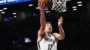 Brooklyn Nets' guard Joe Harris sinks a layup