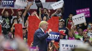 Republican presidential nominee Donald Trump makes his way