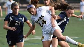 Samantha Roth of St. Anthony's is defended by