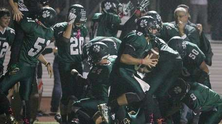 Lindenhurst's players celebrate the overtime win over William