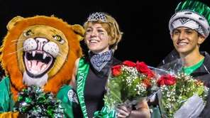 Farmingdale HS Dalers Mascot congratulating the Homecoming King