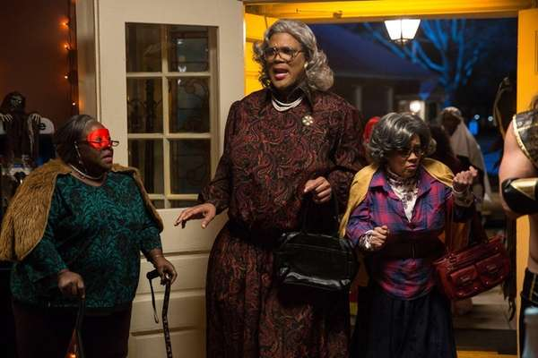Tyler Perry, center, with Cassi Davis, left, and