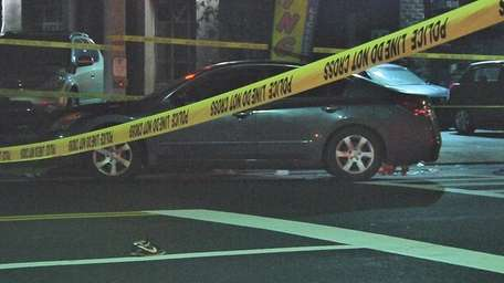 Police caution tape drapes an area where a
