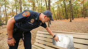 Suffolk County police Officer Kenneth Michaels examines a