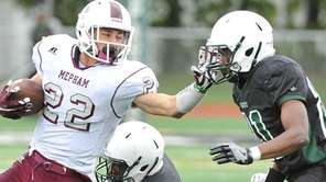 Michael Valentino of Mepham runs upfield against Elmont