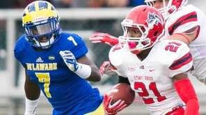 Stony Brook running back Stacey Bedell breaks through