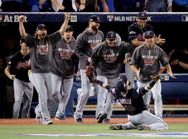 Cleveland Indians' first baseman Carlos Santana celebrates with