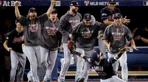 Cleveland Indians' first baseman Carlos Santana celebrates with