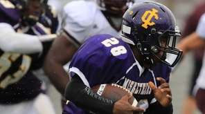 Central Islip's Ishmael Wade #28 carries the ball