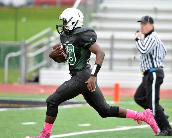 Joshua Milfort of Elmont running for a touchdown