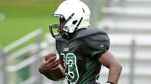 Joshua Milfort of Elmont running for a touchdown