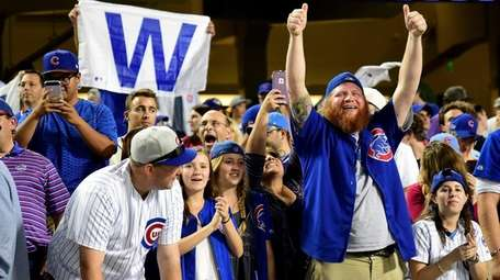 Chicago Cubs fans celebrate after the Chicago Cubs
