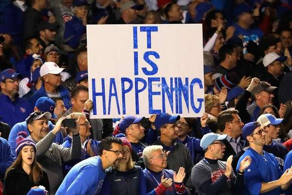 Fans hold up a sign during Game