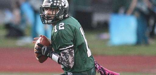 Lindenhurst's Austin Perri gets ready to pass in