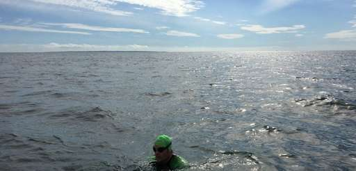 Christopher Swain, a clean-water advocate, is currently swimming