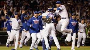 Chicago Cubs players celebrate after Game 6 of