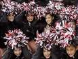 Patchogue-Medford High School cheerleaders pose while sheltering themselves