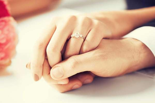 A wedding ring on a bride's hand.