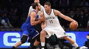 New York Knicks center Joakim Noah defends Brooklyn