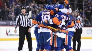 New York Islanders players celebrate a goal by