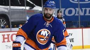 Islanders defenseman Nick Leddy guards agains the Minnesota