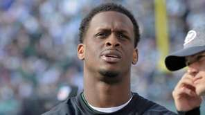 New York Jets quarterback Geno Smith, left, watches