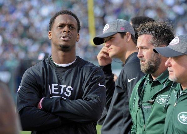 New York Jets quarterback Geno Smith, left, watches