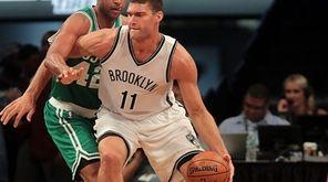 Nets center Brook Lopez (11) works against