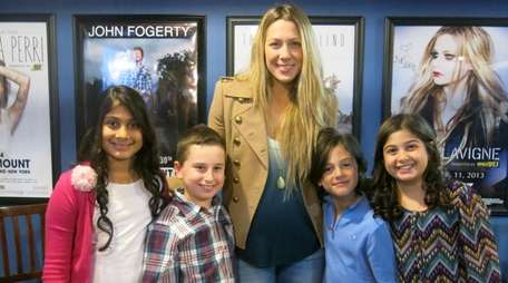 Singer Colbie Caillat with Kidsday reporters, from left,