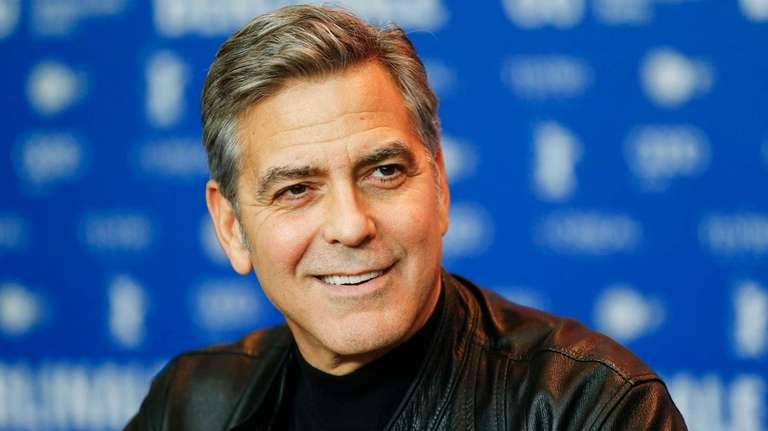 Actor George Clooney attends a press conference for