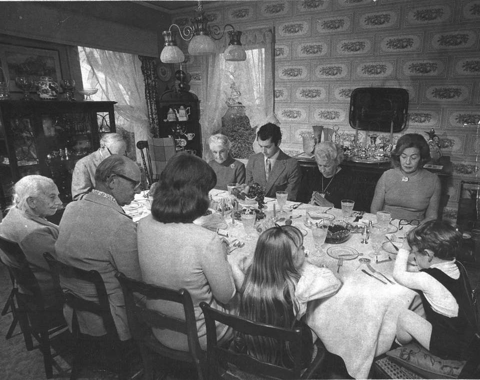 The Foster family says grace at their Thanksgiving