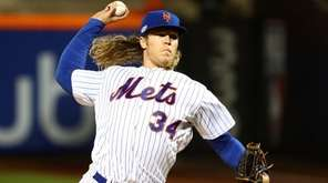 Noah Syndergaard pitches against the San Francisco Giants