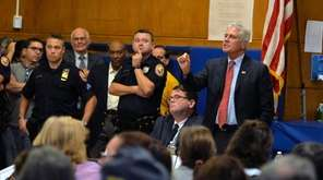 Hempstead Town Councilman Bruce Blakeman addresses questions about