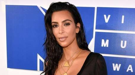 Kim Kardashian drops lawsuit after website issues apology