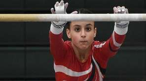 Connetquot's Sarah Moussa competes on the uneven bars