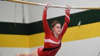 Connetquot's Elizabeth Young competes on the uneven bars