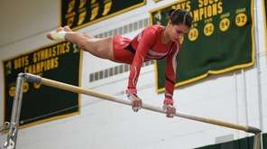 Connetquot's Amanda Pisano competes on the uneven bars