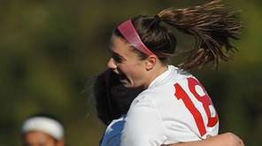 Rachel Florenz of East Islip, right, gets congratulated